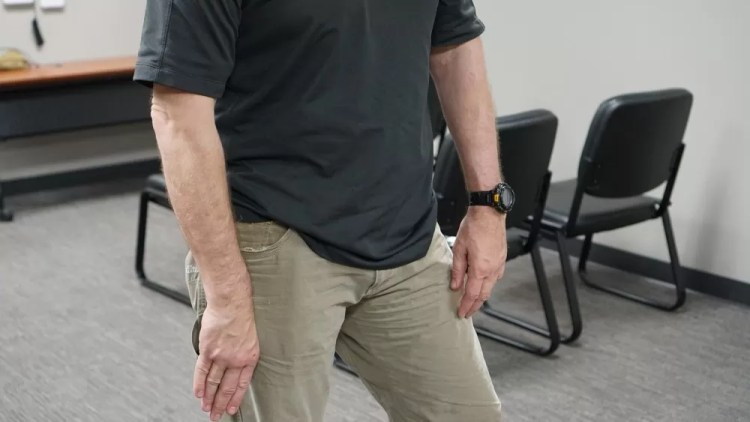 Example of palming concealment position - a concealed carry knife is useless if you do not know how to use it.