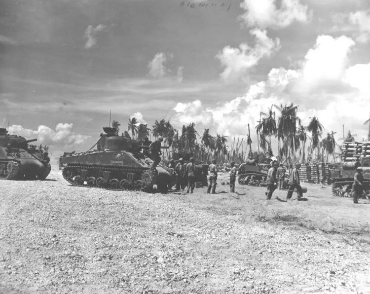"""M4 Sherman tank named """"Colorado"""" helping clear Japanese strongpoints during the Battle of Tarawa."""
