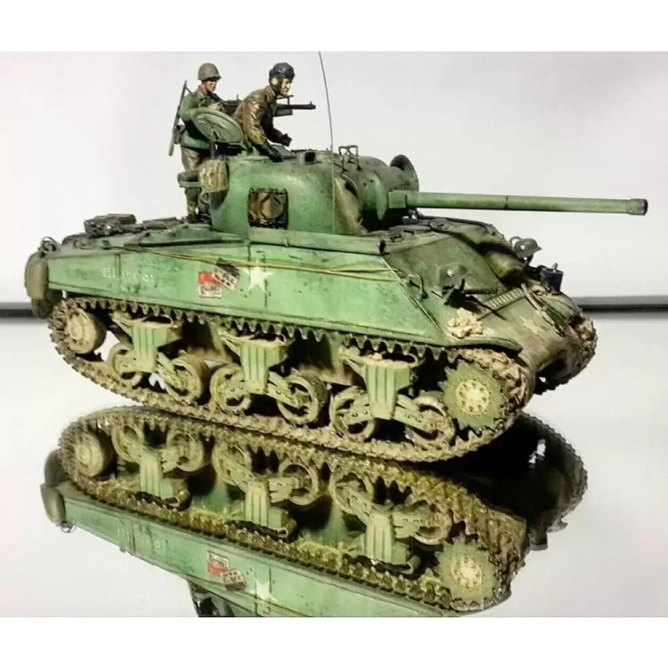 In this installment of tank week: 5 of the best 1/35 scale and other scale model tank modelers around. Oddball's Sherman tank from Kelly's Heroes.