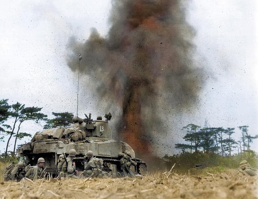 A Sherman Tank, unknown unit, at Okinawa April 1945. US Army Signal Corps.