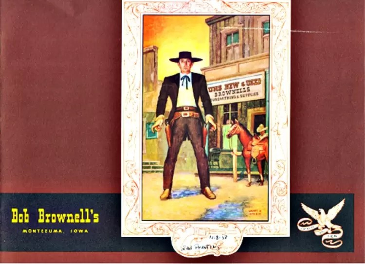 This is the cover of the Brownell firearms supply catalog #10. It features Bob Brownell as a cowboy standing in the middle of a dirt road in front of the storefront.