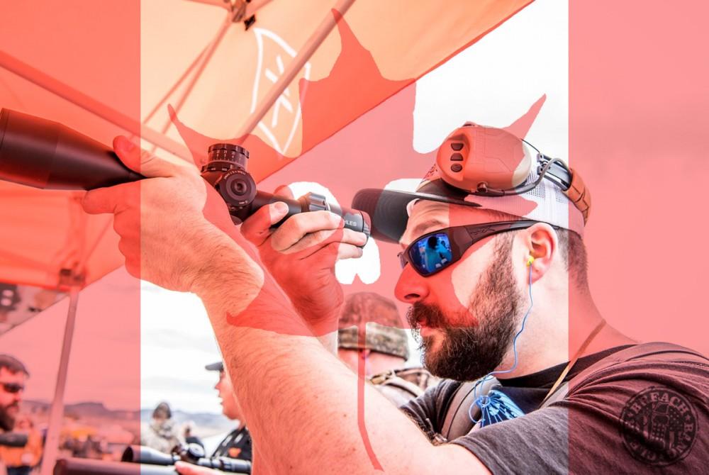 Ryan Houtekamer looking through a Kahles Scope