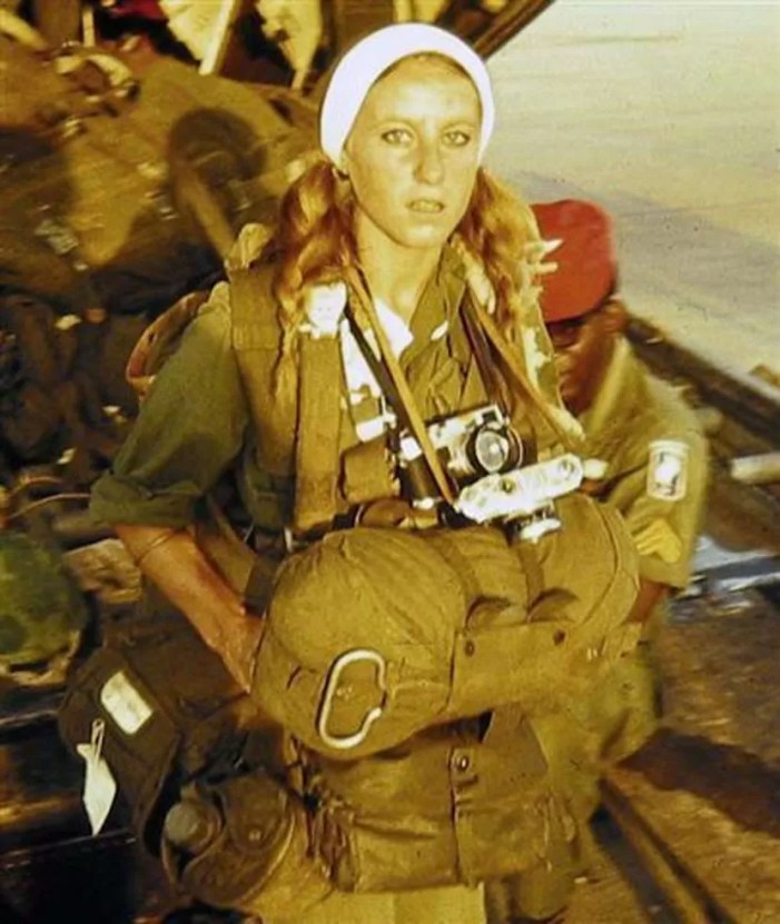 French war correspondent Catherine Leroy preparing to jump.