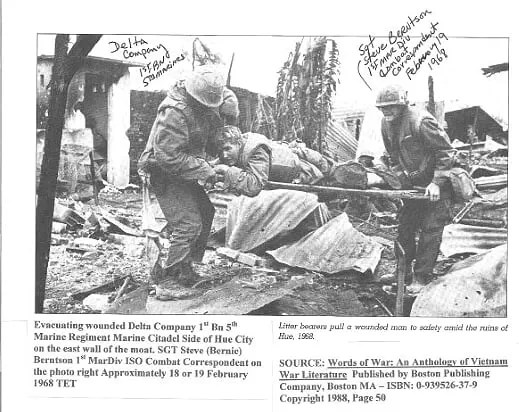 Steve Berntson, right, helps evacuate a wounded Marine in Hue not long before being seriously wounded himself