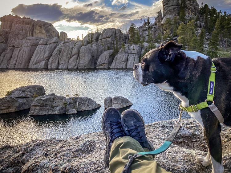Lowa hiking boots with dog south dakota lake view.