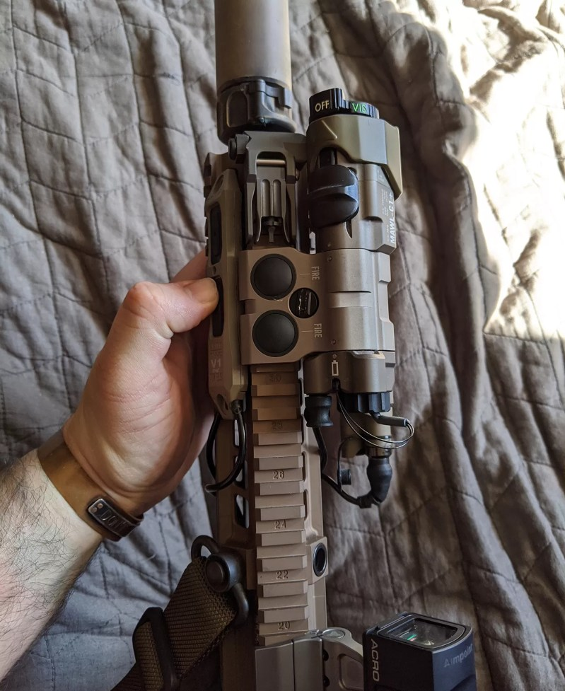 TAPS Sync on DARC informed HK416 with MAWL, Aimpoint Acro, Elcan SpectreDR, Surefire Scout, and other accessories configured for CQB.