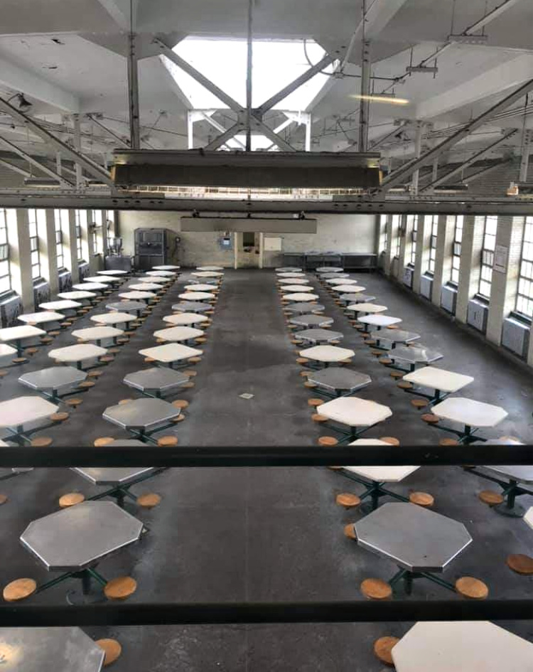 An inmate dining hall, attached to the end of a cell block.