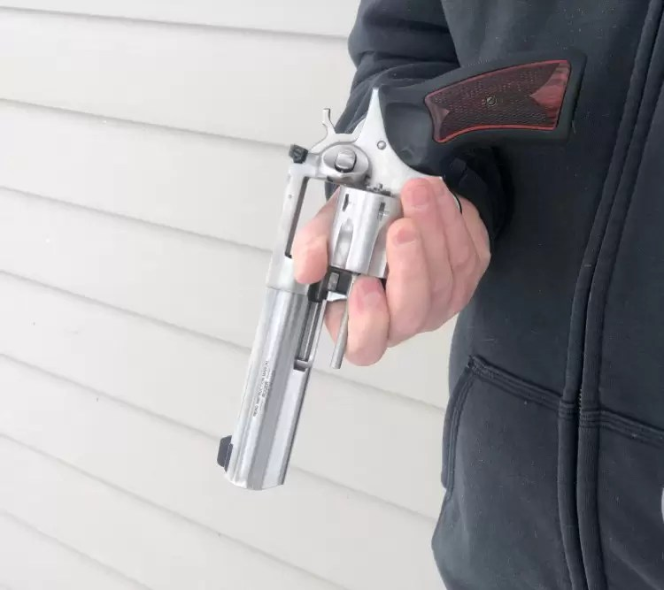 left handed revolver reloading step 5, muzzle down