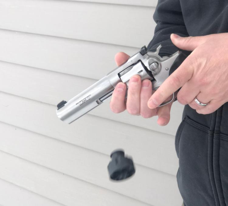 left handed revolver reloading step 8, close cylinder