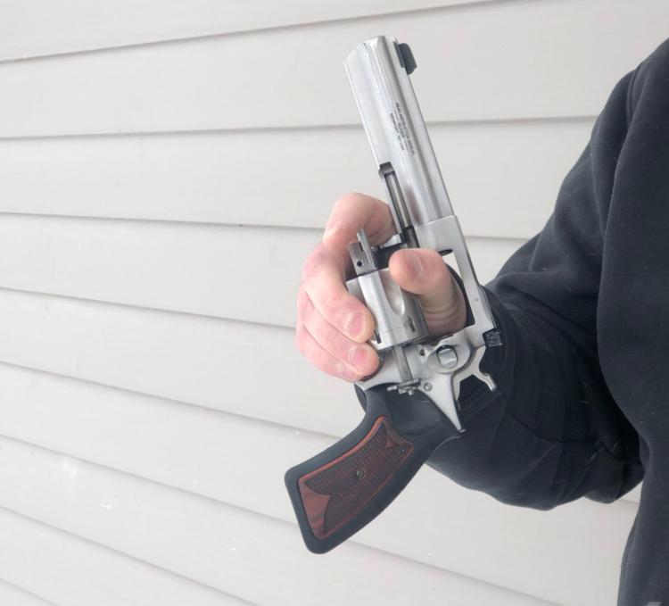 left handed revolver reloading step 4, ejector rod