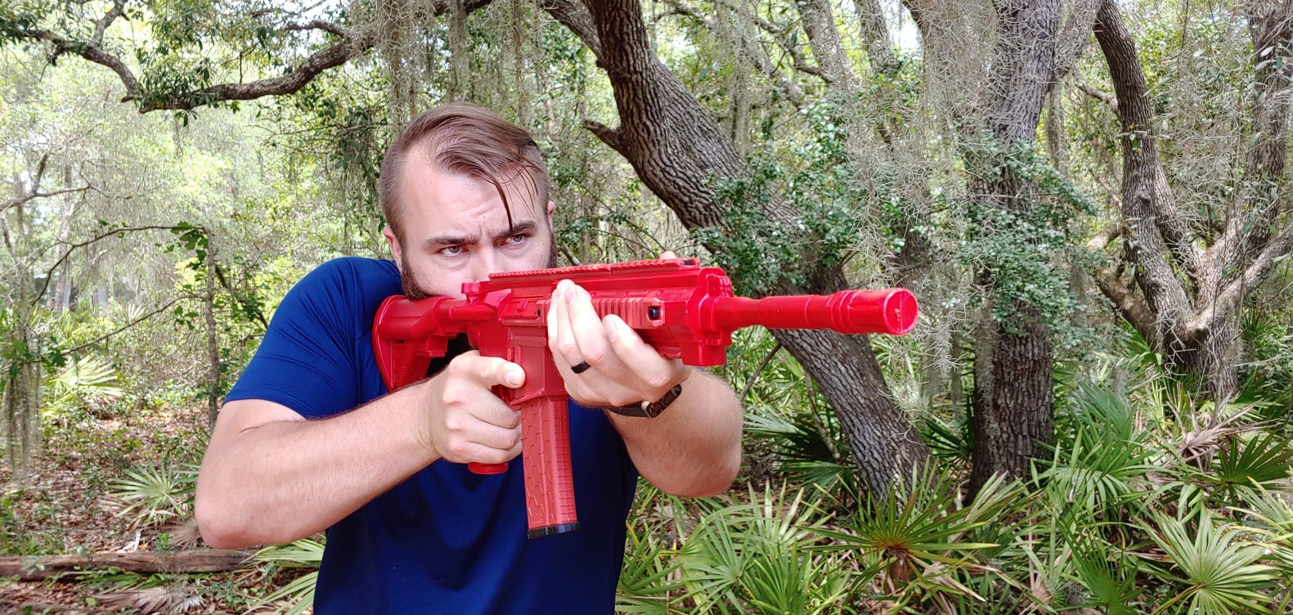 Travis Pike with ASP Enhanced H&K 416 red training gun
