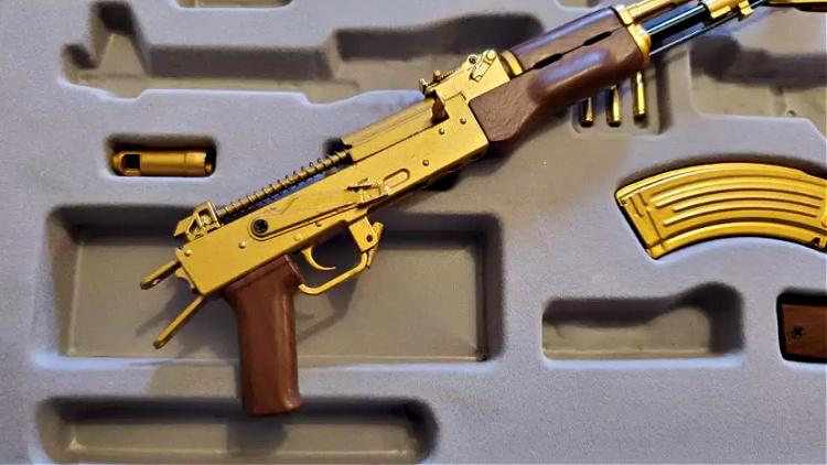 toy golden AK-47 bolt carrier