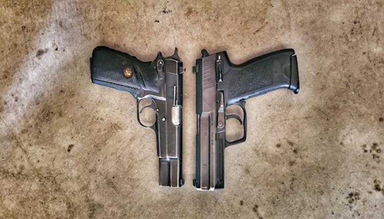 Browning Hi-Power next to HK USP .45