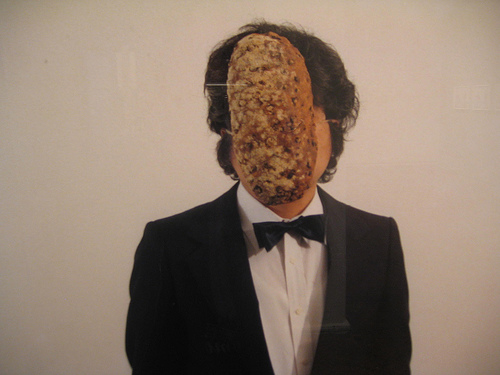 artist with bread tied around his head