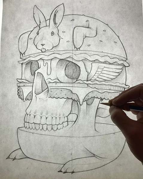 drawing of a bunny with a skull forming a burger