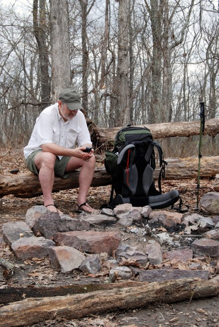 Gary was listening to the weather radio while sitting next to a fire ring at the summit of Bell Mountain (1702 feet).