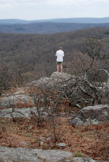 Gary near the summit of Bell Mountain in Iron County, Missouri. It's a drop-off of 700 feet down to the valley below where Shut-In creek runs.