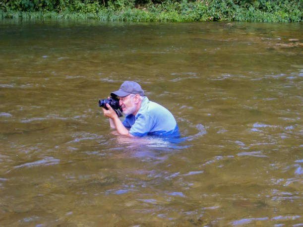 Whatever it takes - Taking a picture of the red bluffs. Huzzah Creek, Red Bluff Campground, Missouri. Picture by Mick Felton