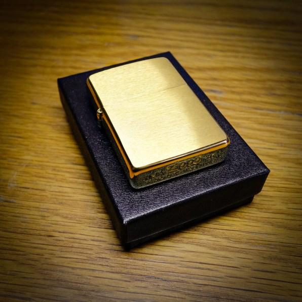 Photograph of a brass Zippo lighter