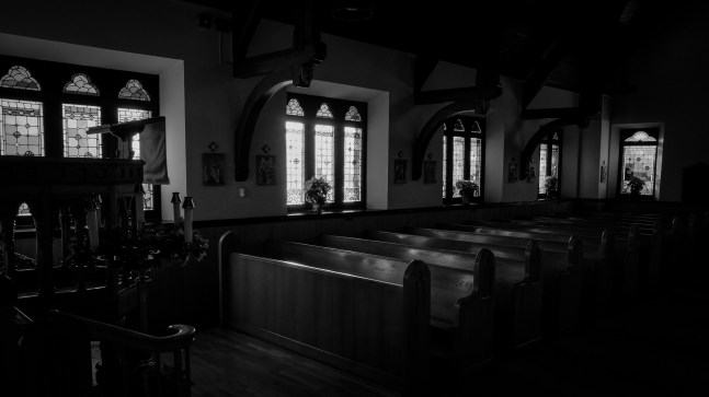 Black and white picture of the Nave of St. John's Episcopal Church, Springfield, MO, bathed in early morning sunlight