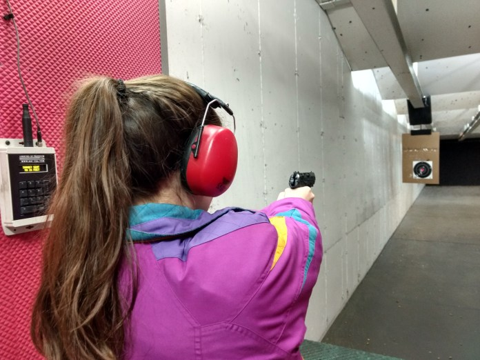 Lanie - on target with the Beretta. Pretty good groupings.
