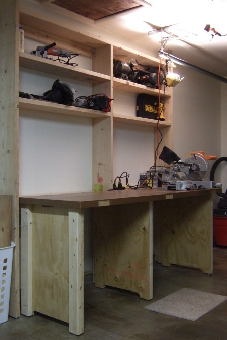 Tra-La! The (almost) finished workbench in the 'Up' position. Just the peg board and some more shelves to add and it is finished. Copyright © 2009 Gary Allman, all rights reserved.