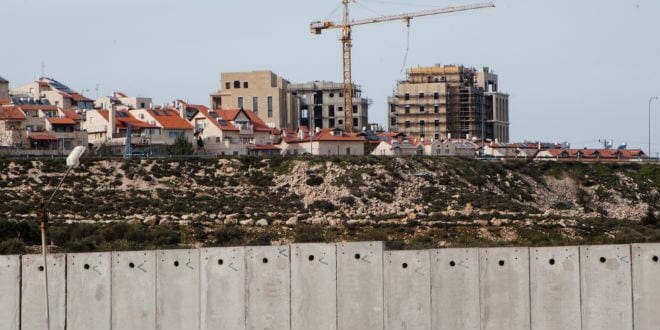 Construction continues in the Israeli town of Gilo, separated from the town of Bethlehem by the Israeli security wall, March 10, 2012. (Photo: Ryan Rodrick Beiler / Shutterstock.com)
