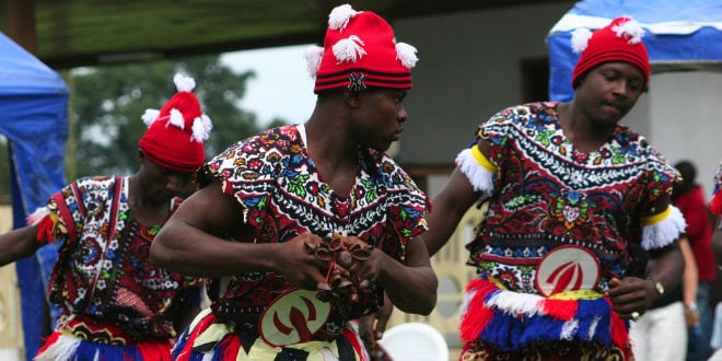 Igbo men perform a traditional dance as part of Independence Day celebrations in the city of Port Harcourt on October 2, 2005. (Lorimer Images / Shutterstock.com)
