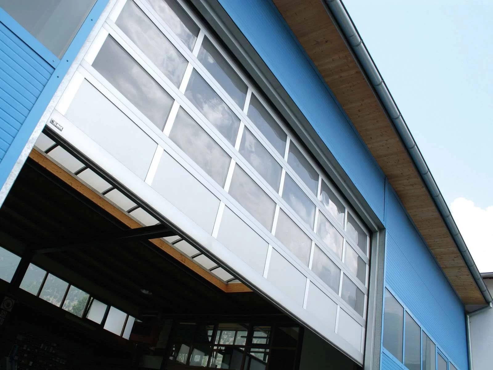 Portone sezionale vetrato LUXOR - Ossidato naturale con tamponamento