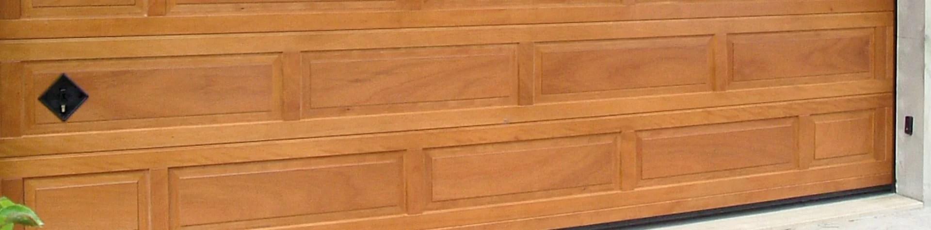 Portoni sezionali in legno massello