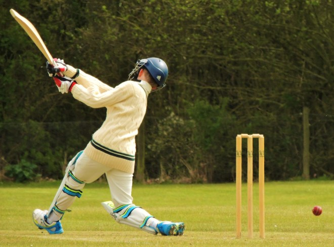 junior cricket batsman in action