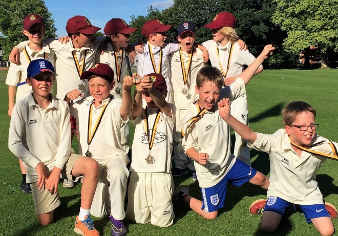 junior cricket team celebrates