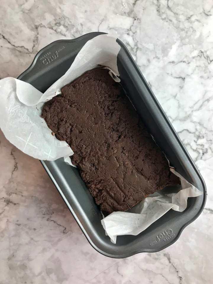Vegan freezer fudge pressed into a loaf pan.