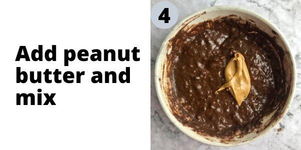 Batter for flourless vegan banana mug cake with peanut butter on top.
