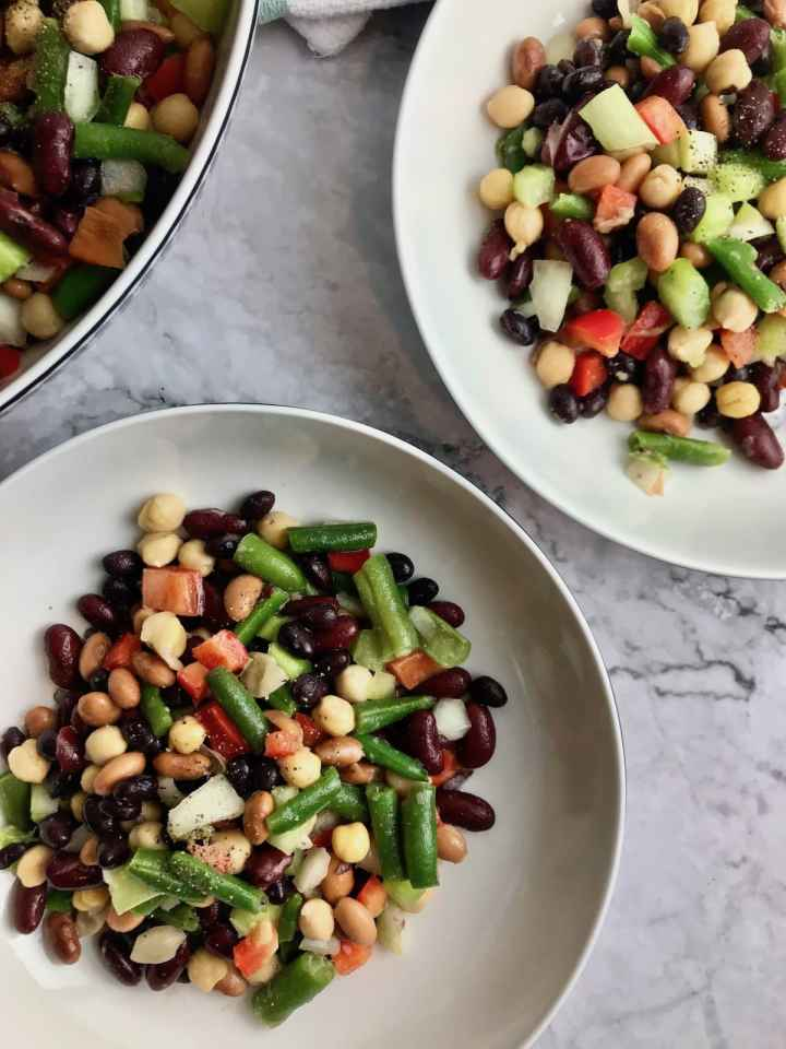 Three bowls of vegan 5 bean salad.