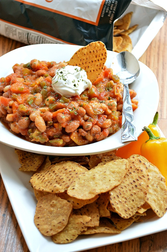 The combination of tangy salsa and sweet potato tortilla chips in this Gluten Free Mango Salsa Chili takes this easy vegetarian slow cooker dish to a whole new level. Try it for a simple, slow cooker weeknight meal.