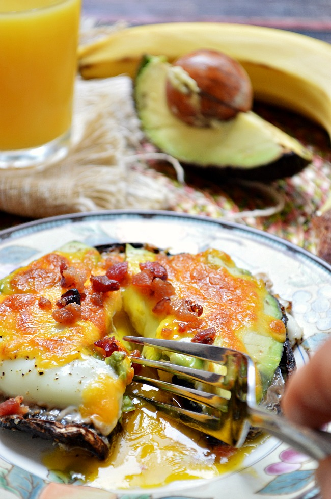 Whether for breakfast or dinner, these Egg, Cheese, and Avocado Stuffed Portabella Mushrooms are sure to leave you feeling full and satisfied. There's nothing like a bright and runny egg yolk to make you smile!