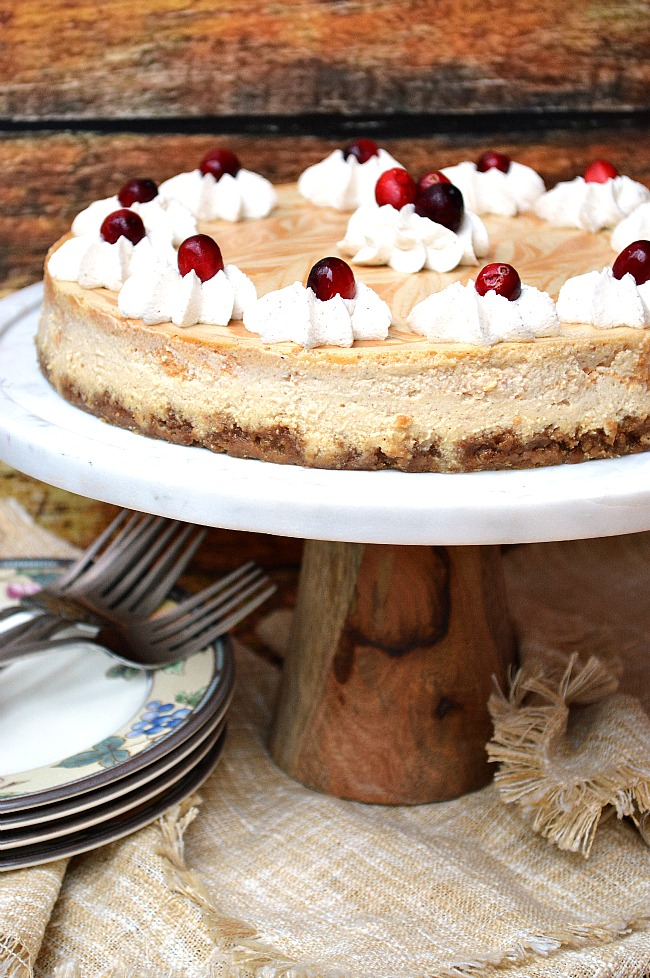 Celebrating the holiday season with this Gluten Free Maple and Molasses Pumpkin Swirled Cheesecake! A mildly flavored maple and molasses cheesecake swirled with a cinnamon spiced pumpkin cheesecake, baked on top of a gluten free molasses graham cracker crust.