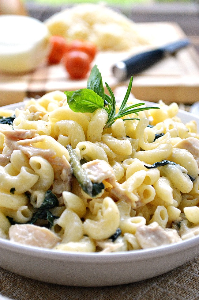 This creamy and cheesy Gluten Free Chicken and Spinach White Cheddar Pasta is a quick and easy weeknight meal and a great way to use up your leftover chicken.