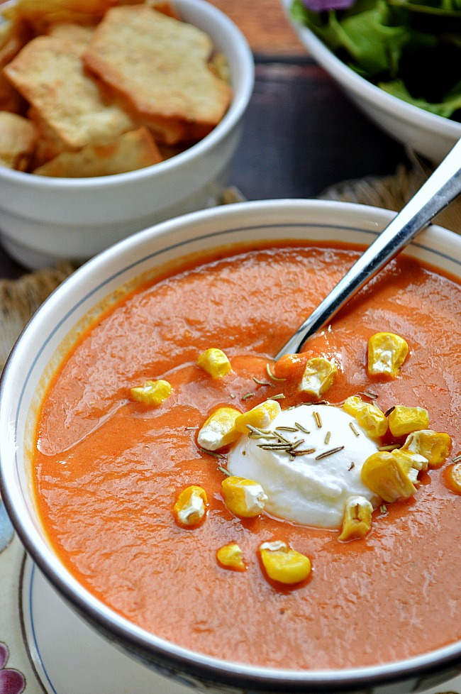 This Roasted Grape Tomato Cream Soup is more robust in flavor than in calories. With deep flavors like rosemary and balsamic vinegar, this soup with be your next grill cheese's best friend!