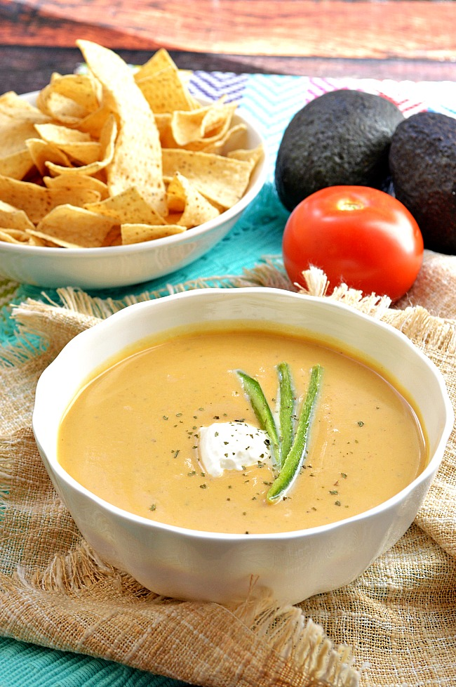This Roasted Jalapeno and Butternut Squash Cream Soup is loaded with rustic Mexican flavors perfect for a fiesta. Adapt the heat level by adding more or less roasted jalapeno seeds and chili powder.