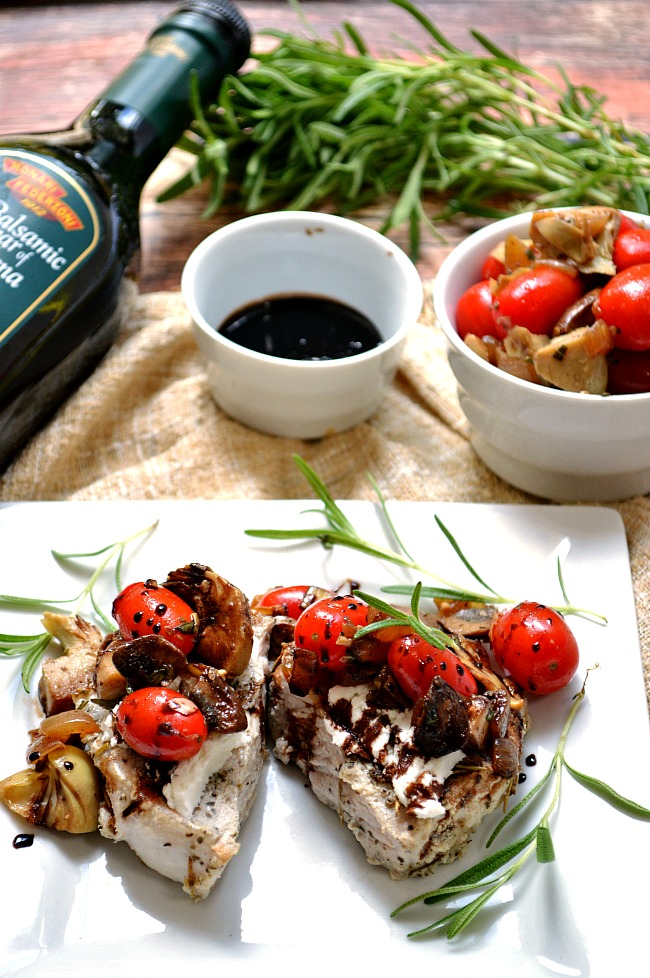 There's too much goodness to love in these Tomato and Artichoke Rosemary Pork Chops with Balsamic Glaze that I can hardly fit it in the title! Flavorful grape tomatoes, onions, artichokes, and mushrooms spooned on top of seasoned pork chops with warm goat cheese and balsamic reduction makes for a fabulous and fancy, comforting meal.