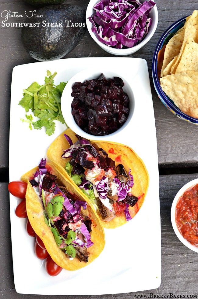 There is no reason to go out when you can make these restaurant worthy Gluten Free Southwest Steak Tacos in your own kitchen. Flavorful, tender steak topped with an array of delicious toppings!