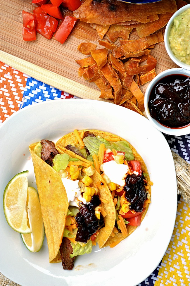 Make your lips burn...in a good way with these sweetly spicy Gluten Free Mango Adobe Style Steak Tacos. Go ahead and spice up your taco Tuesdays!