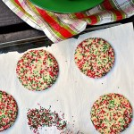 Santa and all his helpers will be overjoyed with a plateful of these bakery style Gluten Free Holiday Sprinkle Sugar Cookies. They are a perfect combo of crispy and chewy with a little crunch of festive sprinkles.