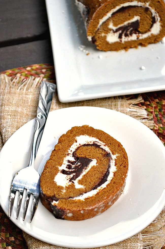 Ring in the holidays with a yuletide log...a Gluten Free Pumpkin Roll with Cream Cheese and Chocolate Ganache Filling to be exact!