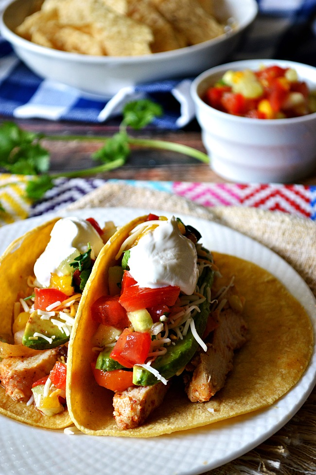 It's a flavor explosion in these authentic street like tacos! You won't be able to pass up one, two, or maybe three of these Gluten Free Chicken Fajita Tacos.