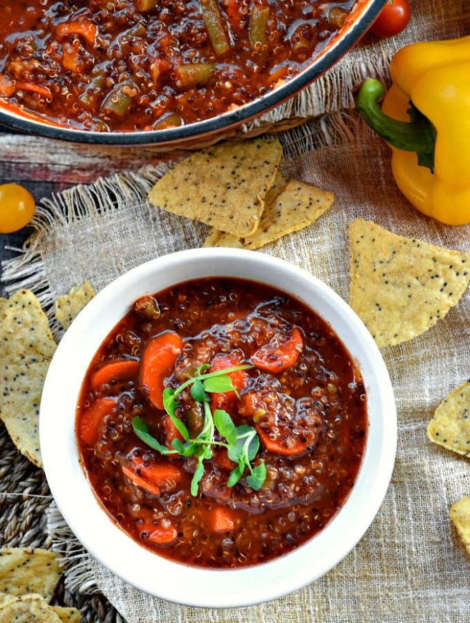 Cozy up with a bowl of this superbly healthy Vegetarian Quinoa Tomato Soup. It's loaded with veggies and hearty quinoa so you won't even miss the meat!
