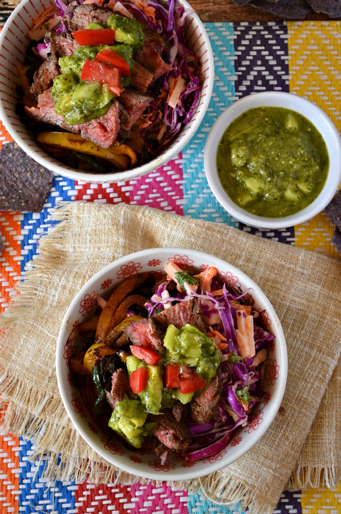 Talk about the flavors in these Burrito Bowls with Tomatillo Avocado Salsa! The warm spices on the steak pair perfectly with the sweet slaw and spicy salsa.