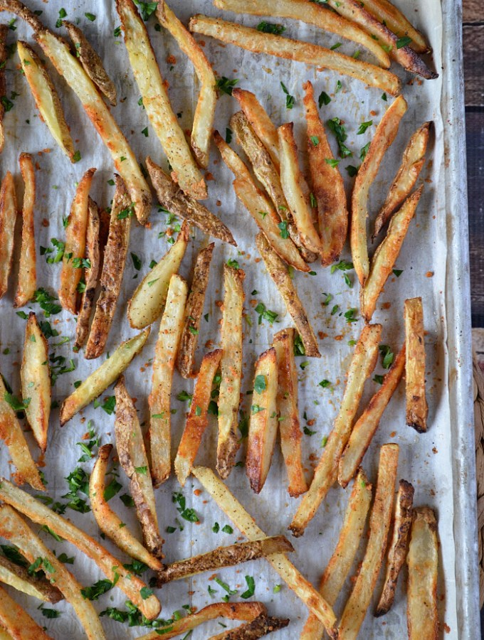 Accompany those summer burgers with these crispy and healthier Oven Baked Parmesan Fries. You won't believe the crunch!